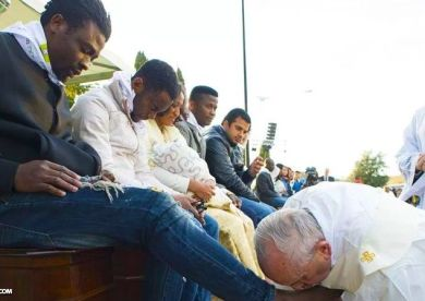 Pope washes feet